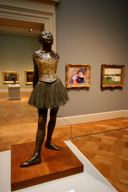 A Degas stands surrounded by masterpieces of Impressionist art at the St. Louis Art Museum.