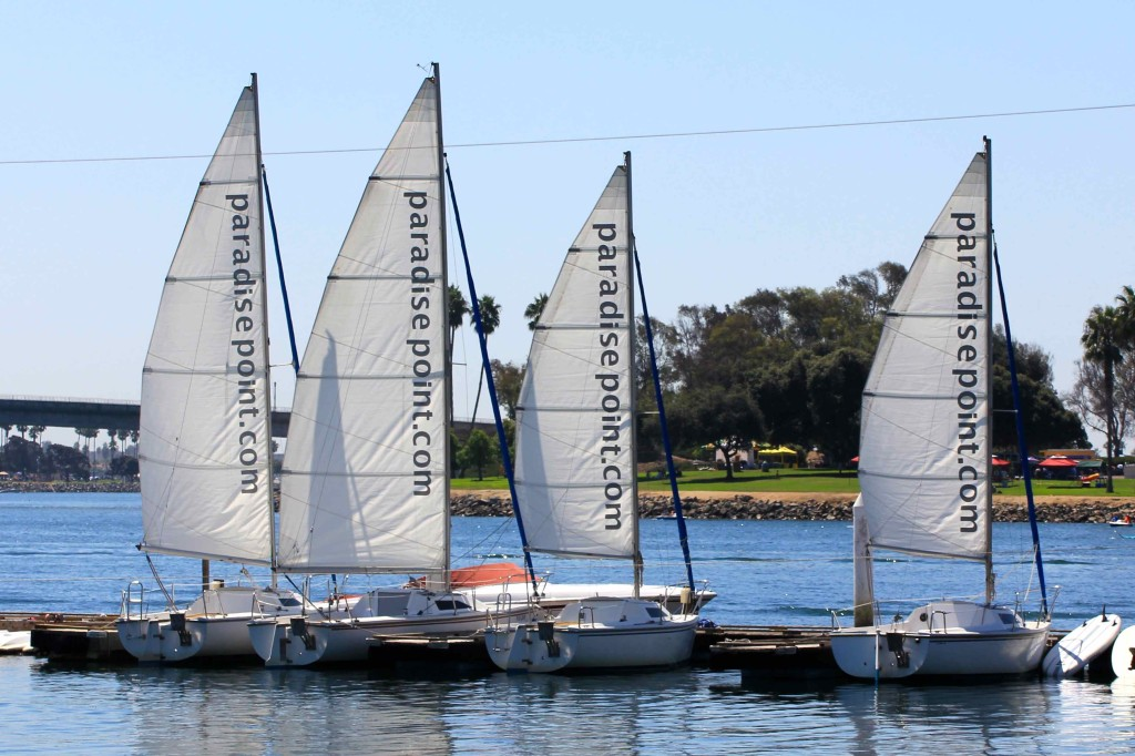 Sailboats idle in tranquil Mission Bay at San Diego's Paradise Point.