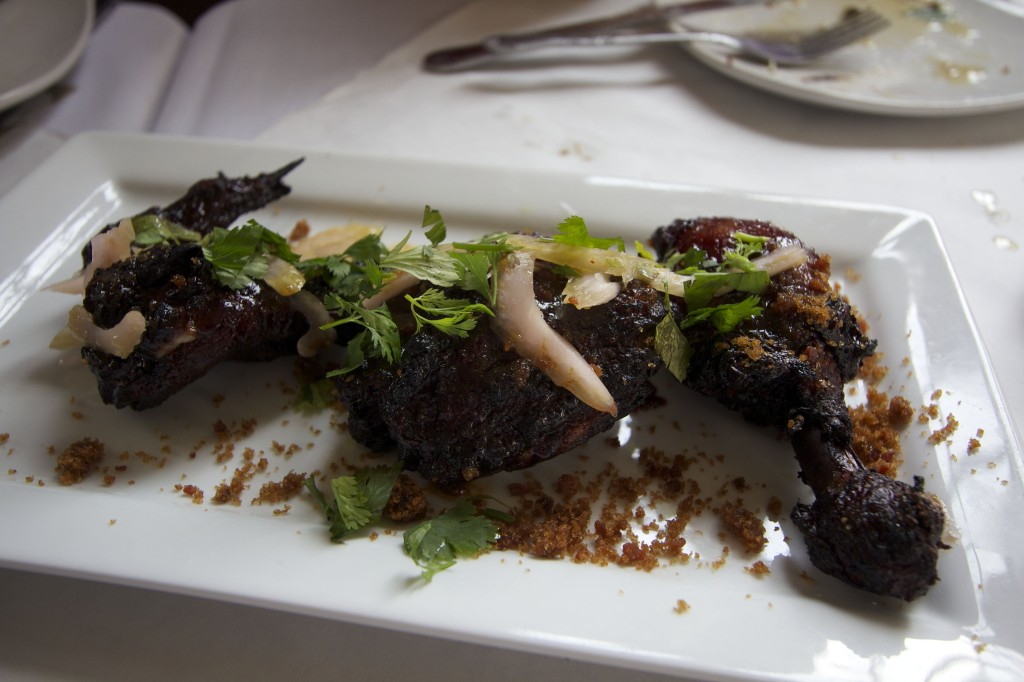 Coq au vin with candied bacon dust, red wine and celery salad at Rodin Restaurant. Photo ©Robert Bundy