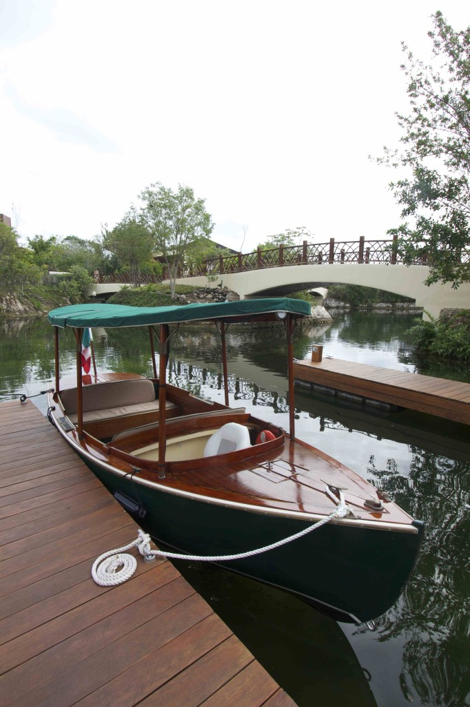 "A charming old-fashioned covered launch glides guests on tours of the pristine, spring-fed waterways that vein this ""Venice of the Yucatan."""