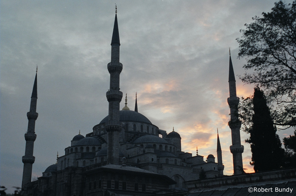 The sun sets over the Blue Mosque in Istanbul.