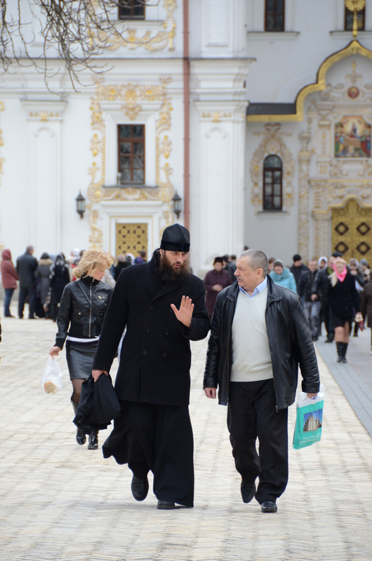 A monk chats with one of the faithful at Lavra Monastery.