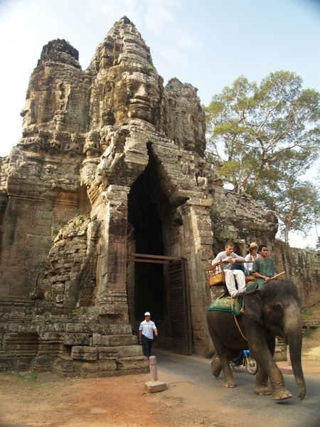 Entering the gate to Angkor Thom, tourists arrive by elephant.