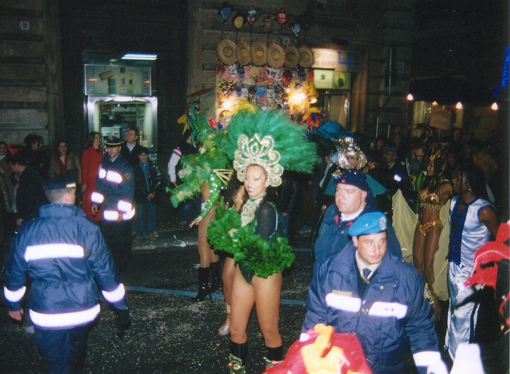 A dancer is accompanied by her beloved security detail.