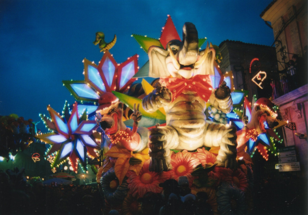 A colorful float lights up the street in Acireale's Carnevale. All photos ©Kevin Revolinski.